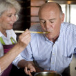 Senior couple cooking together — Stock Photo