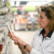 Woman in a supermarket — Stock Photo