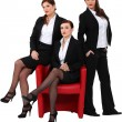 Three elegant women in suits posing — Foto de stock #11847745
