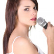 Young brunette woman singing — Stock Photo #11847781