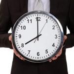 一个商人持有一个时钟的裁剪的图片 — 图库照片