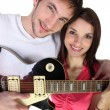 Couple with electric guitar — Stock Photo