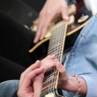 Electric guitar lesson - Stock Photo