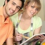 Couple following a recipe — Stock Photo #11847797