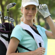 Foto Stock: A smiling female golfer.