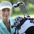 Lady golfer with clubs — Stock Photo #11847808