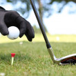 Closeup of a man placing a golf ball on the tee — Stock Photo