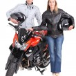 Man and woman with motorbike — Stock Photo