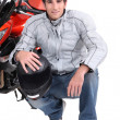 Man kneeling by motor bike — Stock Photo