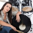 Woman posing with her drum set — Stock Photo #11847844