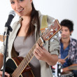 Stock Photo: Womwith acoustic guitar