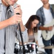 Royalty-Free Stock Photo: Young man singing in a band