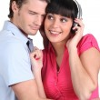 Man and woman entertaining listening to music — Stock Photo