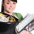 Young woman recycling paper - Stock Photo