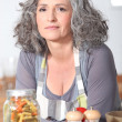 Mature woman posing in kitchen — Stock Photo