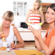 Stock Photo: Young women having breakfast at home