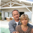 Couple relaxing by the pool — Stock Photo #11848024