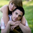 Young couple laying in a park — Stock Photo