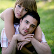 Young couple laying in a park — Stock Photo #11848038