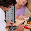 Stock Photo: Computer repairing technician