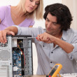 Stock Photo: TV repairman