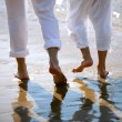 Couple walking barefoot by sea — Stock Photo #11848057
