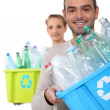 Stock Photo: Couple recycling plastic bottles