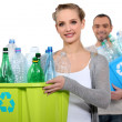 Couple recycling plastic bottles - Foto de Stock  