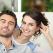 Stock Photo: Couple on white sofa