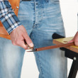 Closeup of carpenter working on workbench — Stock Photo