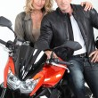 Biker chic with hand on biker's shoulder. — Foto Stock