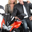 Biker chic with hand on biker's shoulder. — Stock Photo
