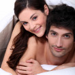 Couple in bed embracing — Stock Photo