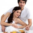 Couple having breakfast in bed — Stock Photo #11848257