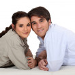 Couple laying on their fronts — Stock Photo #11848283
