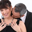 Man kissing his wife on the neck — Stock Photo #11848295