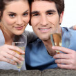 Stock Photo: Couple drinking champagne to celebrate anniversary