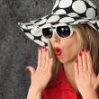 Shocked woman in a hat — Stock Photo #11848339