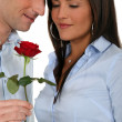 Man offering a rose to his girlfriend — Foto Stock