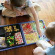 Brother and sister playing a board game — Stock Photo #11848395