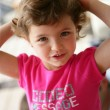 Little girl in a pink t-shirt — Stockfoto