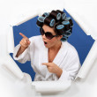Brunette wearing hair-rollers and sunglasses — Stock Photo #11848425