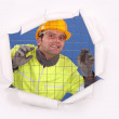Stock Photo: Construction worker behind wire fence