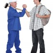 Tradesman making a pact with a young man — Stock Photo #11848628