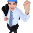 Businessman wearing helmet raising his fist — Stock Photo #11848642