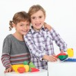 Stock Photo: Portrait of two children playing