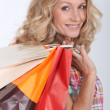 Woman holding two shopping bags — Stock Photo