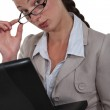 Businesswoman peering over her glasses — Stock Photo #11848841