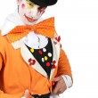 Mmaked up wearing grotesque clown costume and bowler — Stock Photo #11848947