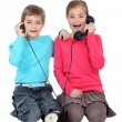 Children with an antique phone — Stock Photo